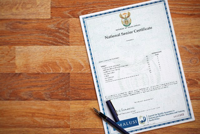 Matric Certificate on table School